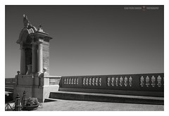 The midday solitude (GP Camera) Tags: nikond80 nikonafsdx1855mmf3556gvr view veduta monument monumento balustrade balaustra floor pavimento sky cielo midday mezzogiorno light luce shadows ombre lightandshadows lucieombre lighteffects effettidiluce summer estate perspective prospettiva monochrome monocromo bw biancoenero vignetting depthoffield profonditàdicampo solitude solitudine silence silenzio quiet quiete shades sfumature whiteframe cornicebianca italy italia marche darktable gimp opensource freesoftware softwarelibero digitalprocessing elaborazionedigitale