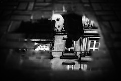 a reasonable depth (ewitsoe) Tags: pddle street city urban puddle rain water reflection tone monochrome blackandwhite earth world erikwitsoe canoneos5ds 50mm urbanite cityscape life living citylife sidewalk poznan poland emmerson