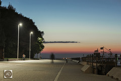 I went to Seacombe to look at the Queen. (alun.disley@ntlworld.com) Tags: theblackpearlnewbrighton dusk wirral people promenade night streetlights trees sky railings path longexposure