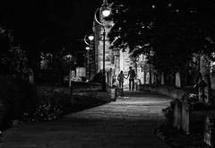 Holding-hands.jpg (+Pattycake+) Tags: night churchyard streetphotograph lighting pavingstones holdinghands photo walking tombstones bw pathway alleyway citywalk
