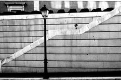 Lamp (chantalllenas) Tags: streetphotography streetphotographers streettogs street streetscene streetbw lamp staircase fujixt1 woman