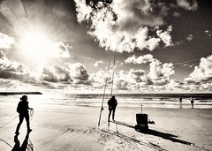 Beach scenery (Marc Gommans) Tags: vakantie zwartwit noiretblanc blackwhite sea fishermen people outdoor noordzee cadzandbad sun zon zee zeeuwsvlaanderen urlaub samsungs7edge lenscase wideanglelens snapseed roos filmnoire grainy monochrome monochroom mono clouds wolken water