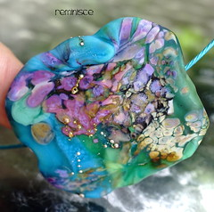 Reminisce (Laura Blanck Openstudio) Tags: openstudio openstudiobeads handmade lampwork glass beads single focal bead necklace choker jewelry pendant murano huge big flat wearable nugget pebble rock lucky charm fine art arts artistic artisan whimsical funky odd stone colorful multicolor organic earthy urban violet purple frit transparent lavander lilac aqua published winner festival show holes grape turquoise blue green sea ocean teal sterling silver dots silvered opaque matte frosted etched glow coral ocher orange grass tropical raku abstract asymmetric