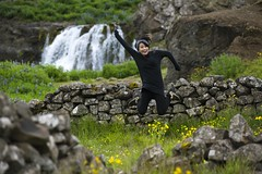 Suspended in Iceland (Arró) Tags: nikon d810 nikkor 80200mm f28 28 zoom lens digital tripod europe iceland hvalfjörður whalefjord water waterfall ruins asian girl woman model portrait jumping smiling fun excited green lush nature flowers cloudy overcast freeze motion high shutter