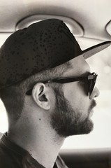 My friend Nikk (davidecerrato) Tags: filmisalive grainisgood grey biancoenero monochrome bnwfilm blackandwhite bnw fomapan ishootfilm fd lens film 35mm filmisnotdead filmphotography filmcamera canon canona1 bn guy car driving hat beard portrait ritratto