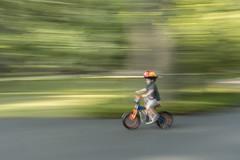Blazing Speed! (mizzginnn) Tags: bike trainingwheels panning slowshutter blur motion child kid helmet nikond500