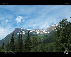 Summer Snow (tomraven) Tags: snow snowcappedmountains montana glaciernationalpark mountains trees tomraven aravenimage tomraveninamerica q32017 fujifilm xt10