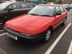 Mazda 323F (Sam Tait) Tags: 16v lights up flip 3door 1992 90s japanese car red classic rare retro sport coupe f 323f 323 mazda