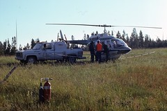1974. Spray helicopter. Douglas-fir tussock moth control project. (USDA Forest Service) Tags: usda usfs forestservice foresthealthprotection stateandprivateforestry region6 r6 douglasfirtussockmoth controlproject sprayproject aerialspray helicopter ddt fireextinguisher supporttruck spray load davemccomb redmccomb 1974