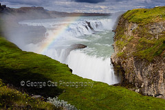 View of the Gulfoss Waterfall, Iceland (George Oze) Tags: flow flowing goldencircle hvítáriver iceland nordic summertravel arctic attraction attractiongorge background beautiful beauty bubbles canyon cascade circle clouds color colorful curtain europe exciting extreme famous fog geothermic glacier golden grass grassland green gullfoss horizontal landmark landscape landsfcape meadow mist mountains nature north outdoors place pouring powder power rainbow rising river roaring rocks rushing seasons spectacular spray stirring thundering tourism tourists travel water waterfall whirlpool is