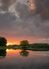 Fire Sky Reflections (59roadking - Jim Johnston) Tags: ifttt 500px sunrise lake sunset reflection pond sundown dawn bohinj still water lakeside mirroring view rushes bled placid waterlilies etang