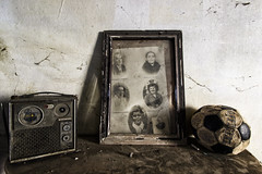 Nostalgic (Giorgio Marra) Tags: urbex photography dust lost darkness empty abandoned forgotten decay italy mansion contrast echoes time memories silence past radio ball soccer old photo family portrait frame indoor light shadow dark canon