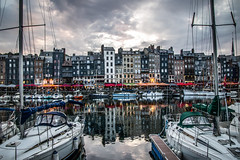 """The lights coming on as summer evening falls, fine art colour, Vieux Bassin, Honfleur, Calvados, Normandy, France (grumpybaldprof) Tags: fineart """"fineart"""" impressionist impressionistic ethereal artistic shadow light contrast texture tone gloaming evening lights honfleur normandy normandie france calvados """"vieuxbassin"""" """"oldharbour"""" """"quaistecatherine"""" """"quaiquarantaine"""" quai """"quaistetienne"""" """"stecatherine"""" """"lalieutenance"""" quarantaine water boats sails ships harbour historic old ancient monument picturesque restaurants bars town port colour reflection architecture buildings mooring sailing stone collombage halftimbered yachts carousel merrygoround reflections """"waterreflections """"wetreflections""""funfair """"eglisesaitecatherine"""" yacht voillier canon 70d """"canon70d"""" tamron 16300 16300mm """"tamron16300mmf3563diiivcpzdb016"""""""