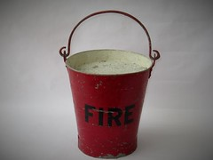 Safety First (IMHILL) Tags: firebucket fire bucket red metal steel galvanised safety safetyequipment fireextinguisher sciencelab retro vintage battered paint sign sand handle shabby used