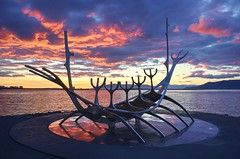 Silent voyage to the sun (PeterThoeny) Tags: reykjavik iceland sólfar solfar sólfarið solfarid sunvoyager monument sculpture reflection water bluehour color colorful blue red orange cloud cloudy dusk night sunset outdoor sony sonya7 a7 a7ii a7mii alpha7mii ilce7m2 fe2870mmf3556oss 1xp raw photomatix hdr qualityhdr qualityhdrphotography sæbrautroad jóngunnarárnason fav200
