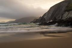 Coumeenole Strand and the steep cliffs of Dunmore Head - Dingle -Ireland 2011 (Wilma v H - Thanks so much 4 your lovely comments/) Tags: coumeenolestrand coastal dinglepeninsula dingle dinglewayhiking blasketislands greatblasketisland inisnabró dunquin dunmorehead cliffs atlanticocean ireland irishcoastallandscape beaches eire sunsets goldenhour clouds blasketsound luminositymasks tkactionsv5panel landscape waterscapes reflections 2011 travel holiday ireland2011 kerry canonpowershotg12
