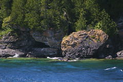 Rocky Cliffs of Fathom Five National Marine Park (Christie Purchase) Tags: island forest tree waves fathomfivenationalmarinepark outside outdoors nature canon rocky ontario tobermory cliff rock saturation vibrant green blue lake bay water