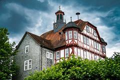 Timbered House (frank kr) Tags: sony sonya7r2 fe50za 50mm timbered street foto haus rathaus hessen germany deutschland fachwerk stadt hdr clouds wolken dunkel dark