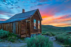 Bodie Ghost Town Sunset (Mimi Ditchie) Tags: bodie bodieghosttown easternsierra ghosttown sunset windows reflections metzgerhouse clouds sky pinkclouds
