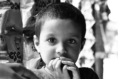 A kid midway (shahriarashraf) Tags: kid girl street curiosity eyes mysterious