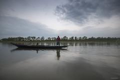 backwaters (subhajyoti) Tags: chilika odisha chilka brackish backwater boatman reflections availablelight subhajyotiroychowdhury india monsoon