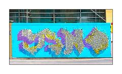 Street Art (Jano), East London, England. (Joseph O'Malley64) Tags: jano streetartist streetart urbanart publicart freeart graffiti eastlondon eastend london england uk britain british greatbritain art artist artistry artwork mural muralist wallmural hordings fencing woodenfencepanels buildingsite constructionsite safetycurtain safetynetting scaffold scaffolding tarmac doubleyellowlines noparkingatanytime parkingrestrictions urban urbanlandscape aerosol cans spray paint fujix x100t accuracyprecision