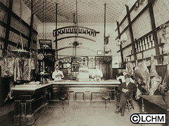 GN376 (Lane County Historical Museum) Tags: eugeneoregon lanecountyhistoricalmuseum vintage historicalphoto oregonhistory digitalcollection butchershop meatmarket shopkeepers downtownbusiness commercialinterior