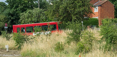 The Lesser Spotted London Bus (M C Smith) Tags: bus red route 379 pentax k3 signs houses grasses bushes green sky blue pole