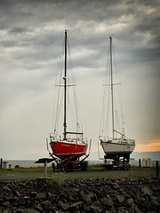 Sailboats at rest (le cabri) Tags: sailboat rest nosail outofwater quiet peaceful night dusk sky iphone peer quebec canada boats