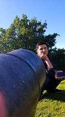 In the line of fire (blondinrikard) Tags: cannon kanon man guy sitting sittinginfrontofthecannon inthelineoffire iskottlinjen kanonen skansenkronan göteborg sweden sverige seated sit
