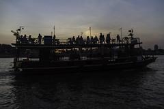 Boat heading to dock (Keith Kelly) Tags: asia bassacriver boat cambodia cruise kh kampuchea mekongriver phnompenh seasia southeastasia tonlesap aroundtown capital city floating ride riding river sunset water