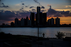Run By The River. Windsor. ON. (Pat86) Tags: photooftheday windsor nikond500 detroitriver renaissancecenter sunset dusk woman running silhouette