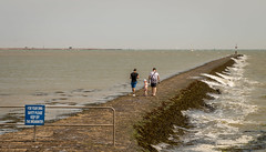 Breakwater (Tony Smith Photo's) Tags: sea water ocean breakwater people sign signpost fence harwich eastanglia essex caring dovercourt father daughter child uk danger warningsign canon eos70d