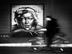 in motion (Sandy...J) Tags: grafitti urban underpass darkness noir blackwhite blurred biker monochrom street streetphotography photography