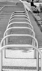 racked with guilt (Harry Halibut) Tags: 2017©andrewpettigrew allrightsreserved contrastbysoftwarelaziness noiretblanc blackwhite blancoynegro blanc weiss noire schwatz bw zwart wit bianco nero branco preto images london1407220409 cycle bicycle motorcycle racks olympic park stratford east london