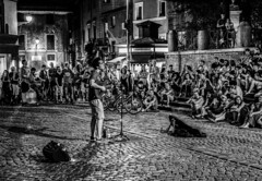 meeting place (thephotographer733) Tags: rome street performer public singer meeting gathering italy crowd bw retro night