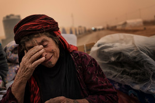 Refugee Camp of Ghazer. Woman crying. Her husband has been interrogated for hours and she doesn't know where to go in this huge camp.