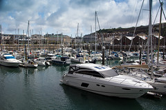St Helier Marina (AnnMelanie) Tags: sthelier jersey channelislands harbour boats water blue sea cranes reflections agapanthus nilelily flower plant bloomsummer sunshine