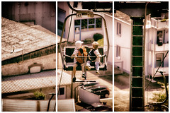 Children in a seat cable car - triptych (Dannis van der Heiden) Tags: triptych cablecar aged children lookingaround cars rooftops 47 high backpack saarburg sesselbahn view germany slta58 sigma18300mm seatcablecar houses dust