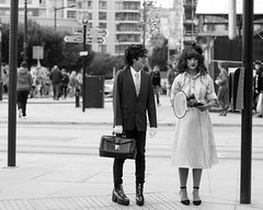 at the crossroad of the worlds (slavamanc) Tags: comiccon city street dressup fancydress manchester urban monochrome blackwhite boygirl gothic makeup festival candid portrait couple character takumar