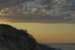 Golden Light over Nauset Light Cliffs (brucetopher) Tags: beach water sea ocean coast evening susnet twilight afterglow horizon cloud clouds light sunlight skies sky colorful bluesea blue golden goldenhour