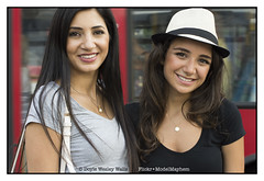 Nathalie and Carla, Bringing Charm and Beauty to Trafalgar Square (Doyle Wesley Walls) Tags: nathalie carla 6002 women girls females smiles hat bus feminine photograph portrait eyes ojos yeux blick ögon ogen occhi olhos face cara faccia gesicht beautiful beau piękny bonita hermosa guapa vacker smuk kaunis bonito lindo schön skjønn fallegur bello sexy séduisant seksowny seductor sexig sexet сексапильный σεξουαλικόσ seksikäs femenino kvinde féminin weiblich femminile kvinna mädchen ragazza flicka fille dziewczyna chica žena mujer femme kobieta donna retrato ritratto porträt portret brunettes browneyes sparklingeyes doylewesleywalls bvlgari bulgarinecklace