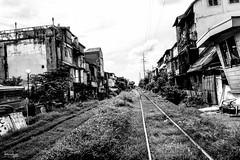 Along the Rails (Daniel Y. Go) Tags: sony sonyrx100m4 rx100m4 philippines street manila pinas railways riles mono bw