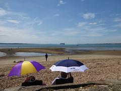 Meon Shore (Gilder Kate) Tags: meonshore titchfieldhaven hampshire thesolent isleofwight sea beach umbrella umbrellas spit shipping panasoniclumixdmctz70 panasoniclumix panasonic lumix dmctz70 tz70