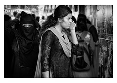 one to one communication (handheld-films) Tags: india street women female portrait portraiture girl niqab burka burqa muslim hindu contrast compare people closeup expression expressives eyes statement communicate religion viewpoints perspectives islamic direct intense blackandwhite monochrome indian subcontinent mono onetoone