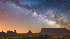 midnight journey (Robert Loe) Tags: explore monumentvalley glow illuminated milkyway galaxy road street journey desert landscape stars wilderness image nikond610 sigmaart20mm14 light sundown sunset sun panoramic panorama robertloe rocks