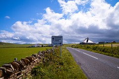 Take the next right for........ (rustyruth1959) Tags: nikon nikond3200 tamron16300mm uk scotland orkney kirkwall twatt finstown roadsign sign road a966 whitelines tarmac outdoor buildings houses fields farmland clouds sky wall verge grass fence farm chimney roof windturbine