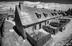 Fort Michilamackinac Rowhouses - Explore (mswan777) Tags: fort michilamackinac mackinaw city michigan history building house wood architecture garden travel nikon d5100 outdoor sigma 1020mm monochrome black white cloud frame