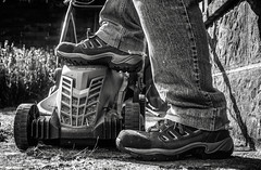 Mower and I. (aquanout) Tags: blackandwhite monochrome shoes feet jeans people wall lawn