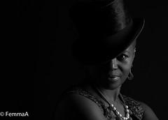 The look (femmaryann) Tags: blackhat blackandwhite looking nightclub smoking smoky beautiful gorgeous commanding sexy woman lady girl mature behold lips mouth earrings